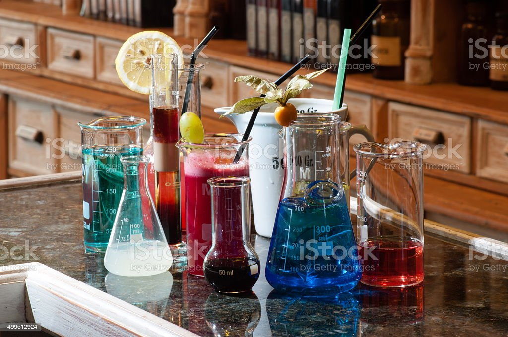 close-up of several chemistry containers different colorful beverages stock photo