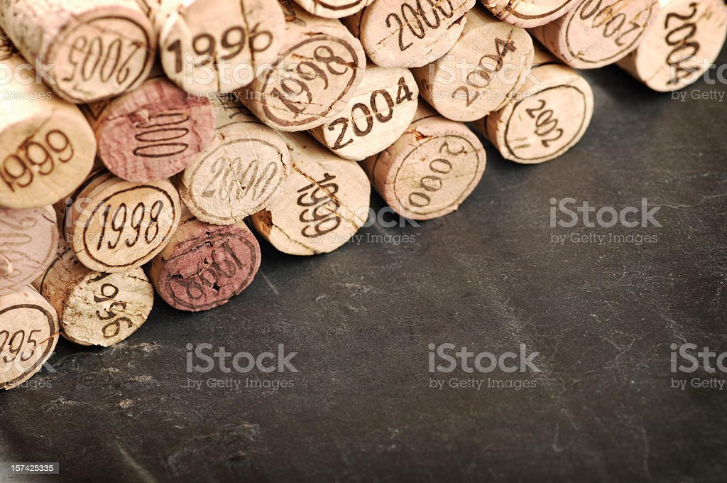 Close-up of several corks stamped with different years stock photo