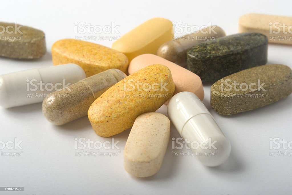 A close-up of several different multivitamins royalty-free stock photo