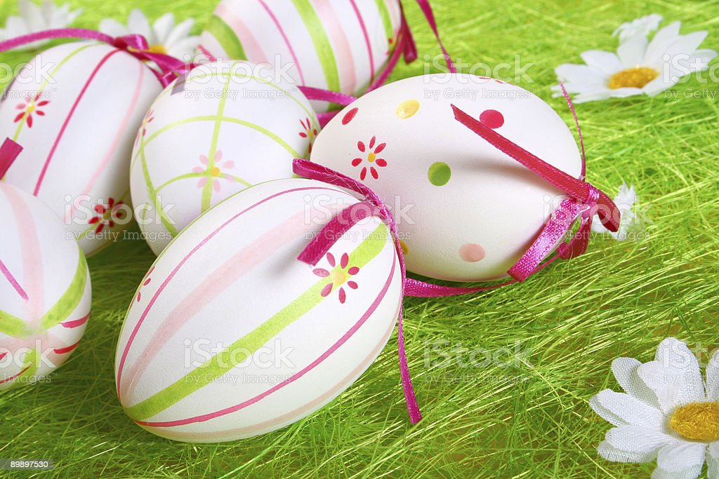 Closeup of several Easter eggs over green grass. royalty-free stock photo