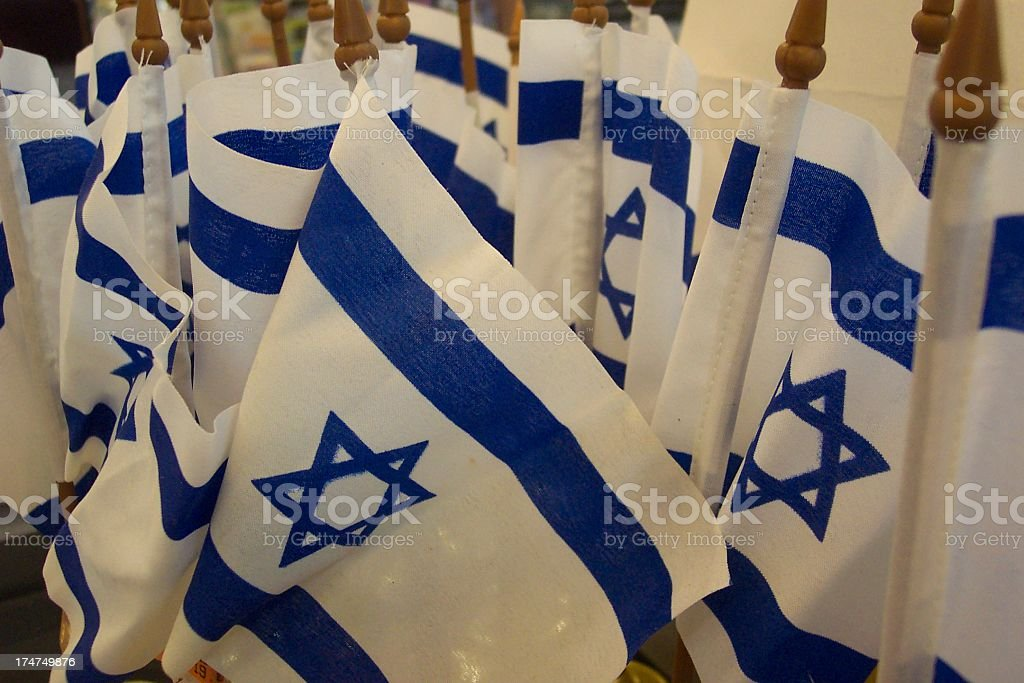 Closeup of several Israeli flags propped upright royalty-free stock photo
