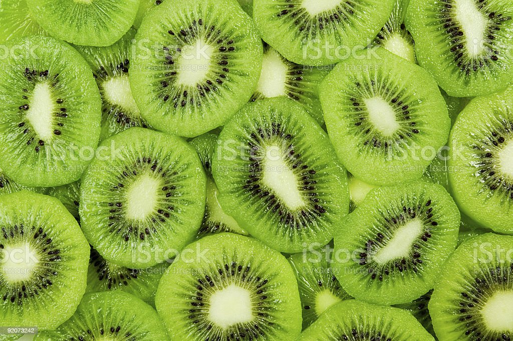 Close-up of several kiwi slices stock photo