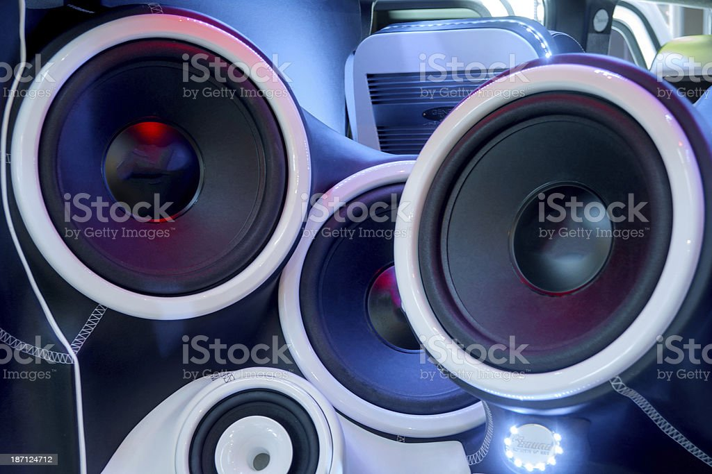 Close-up of several loudspeaker in the back of a car stock photo