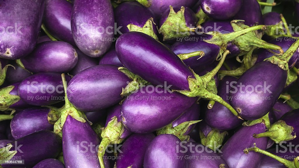 Close-up of several purple eggplants stock photo
