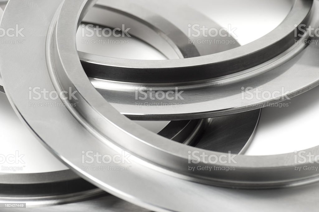 Close-up of shiny chrome rings on a white background royalty-free stock photo