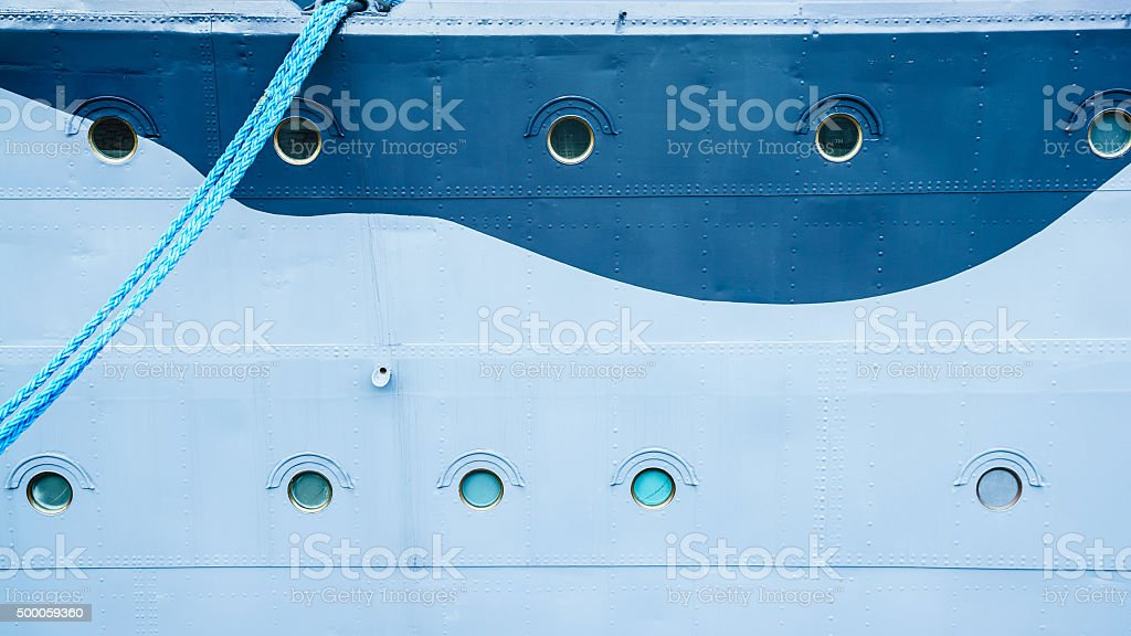 Closeup of ship with hanging mooring rope stock photo