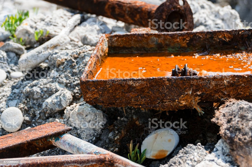 Close-Up Of Shipwrecked Rusty Tank Filled With Water stock photo