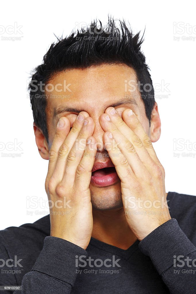 closeup of shocked Man covering his eyes over white background royalty-free stock photo