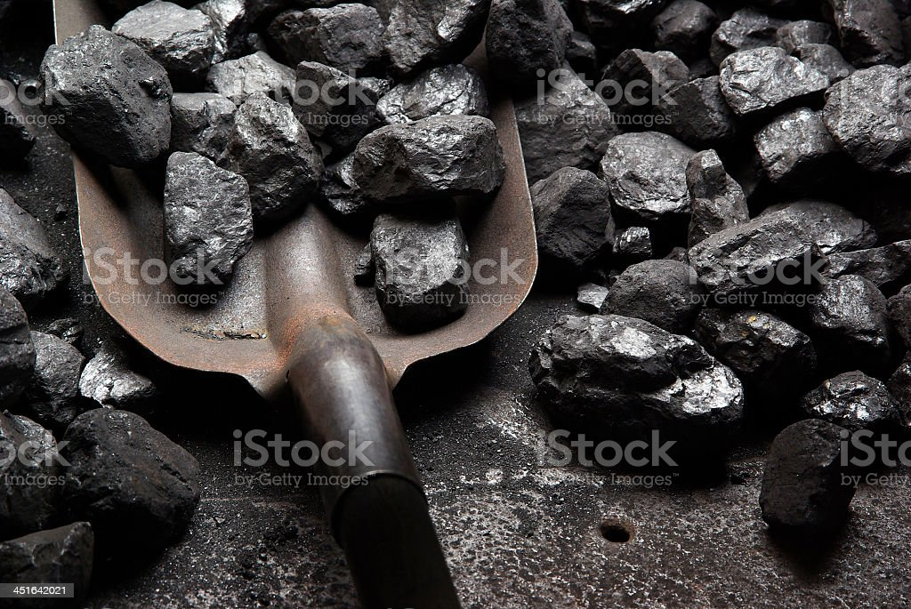 Close-up of shoveling black coal stock photo