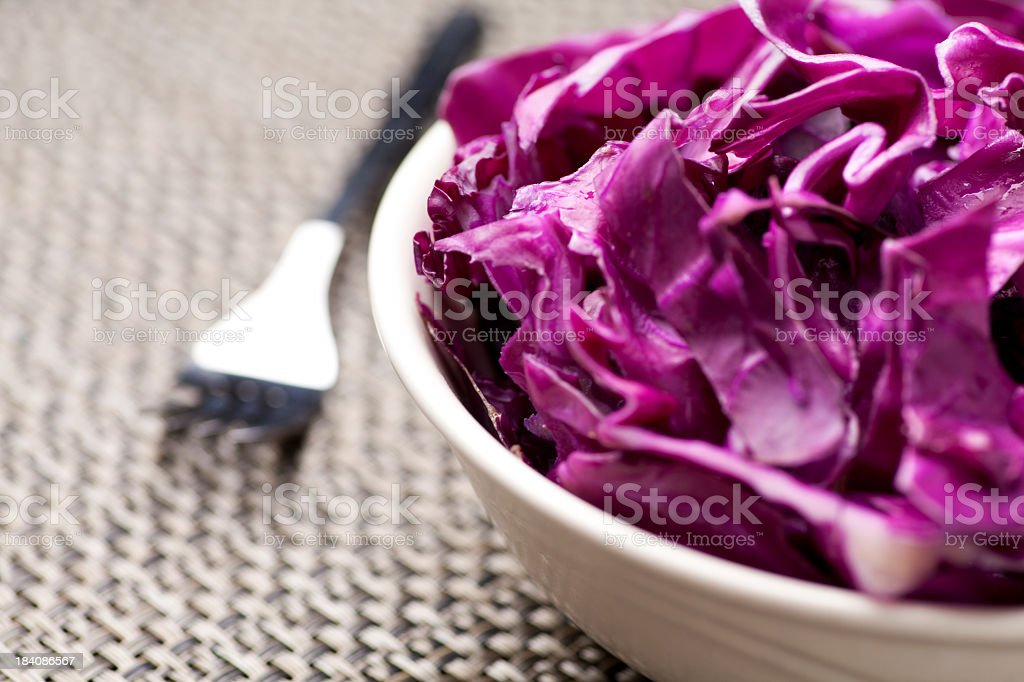 A closeup of shredded red cabbage in a bowl stock photo