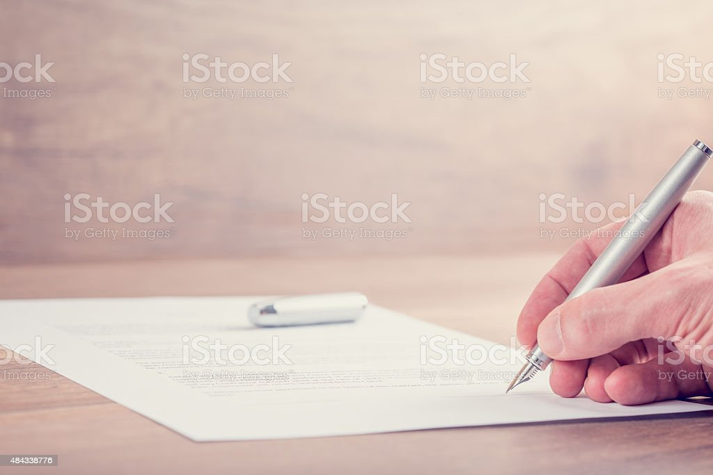 Closeup of signing contract stock photo