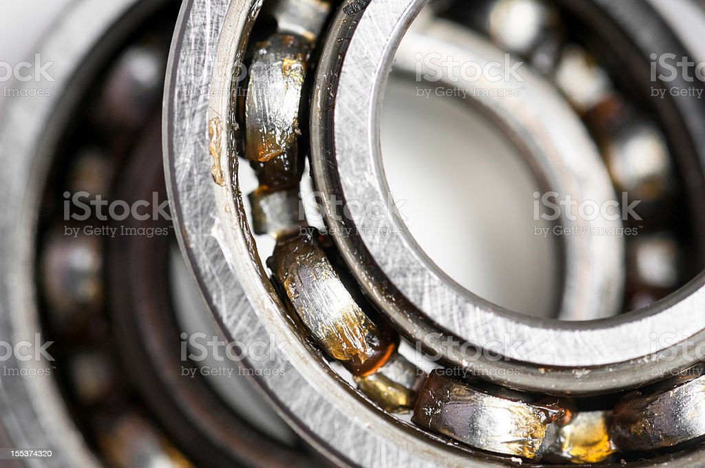 Close-up of silver-colored ball bearing over white backdrop stock photo