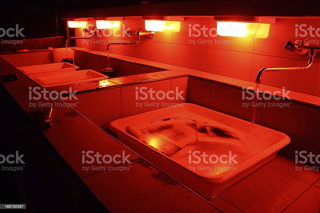 A close-up of sinks in a darkroom stock photo