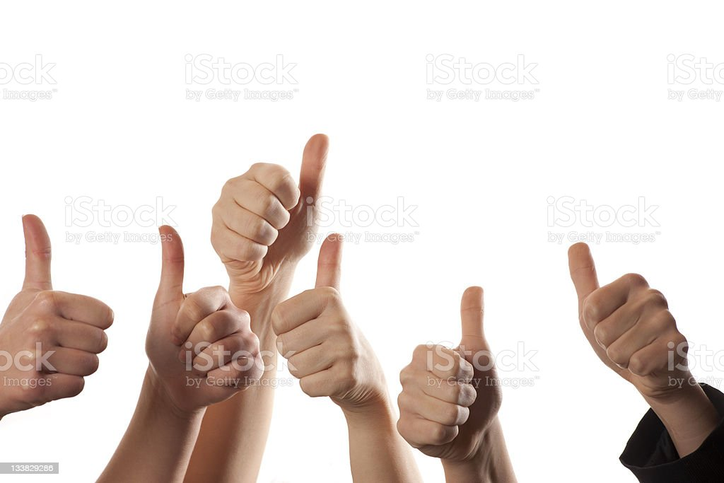 Closeup of six hands giving a thumbs up in the air royalty-free stock photo