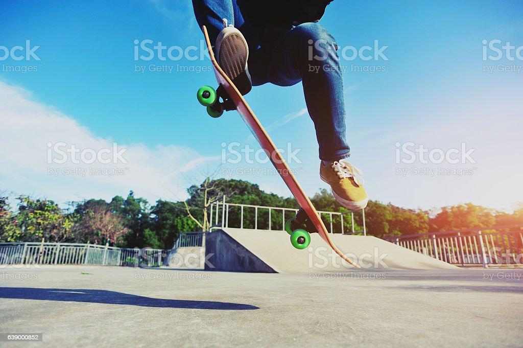 closeup of skateboarder skateboarding on skatepark stock photo