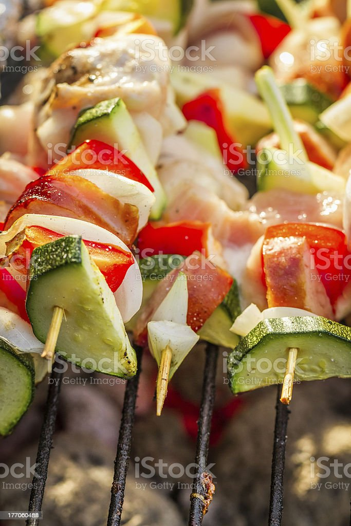 Closeup of skewers with vegetables on the grill royalty-free stock photo