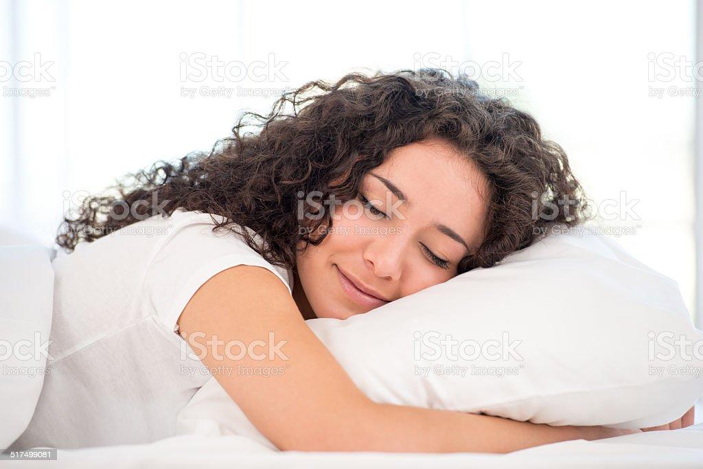Close-up of sleeping happy woman stock photo