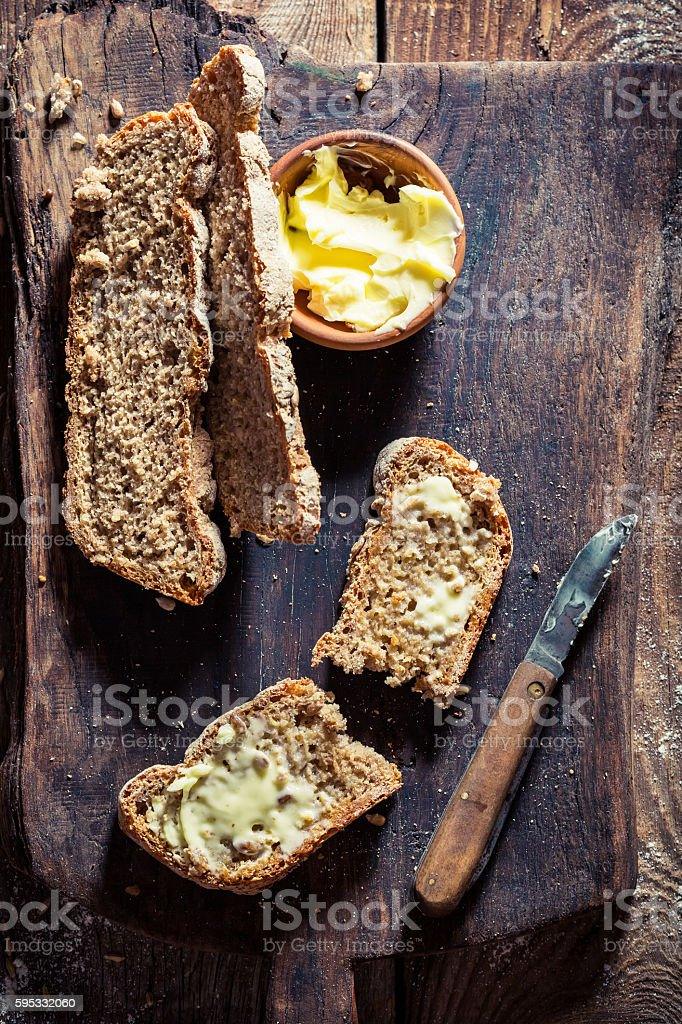 Closeup of slice of bread with butter stock photo