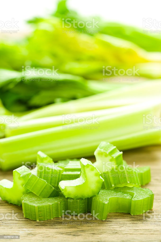 Close-up of sliced celery with whole celery in the back stock photo