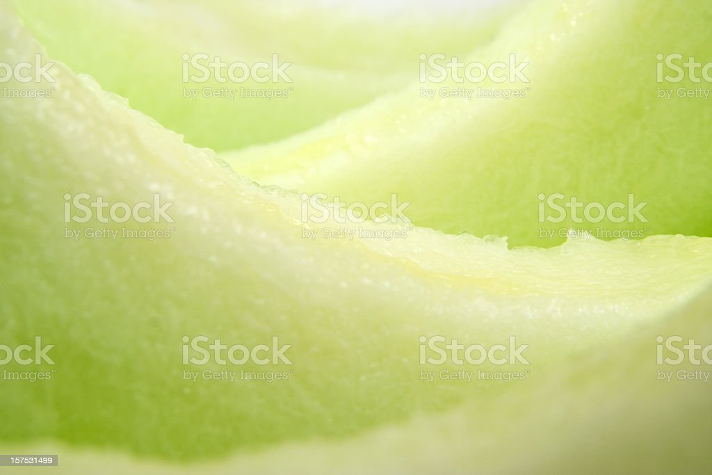 A close-up of slices of fresh, ripe honeydew melon stock photo