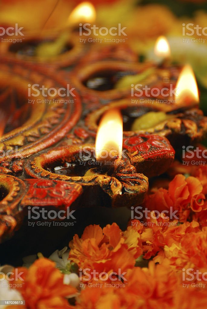 Close-up of small candle in elaborate holder and flowers stock photo