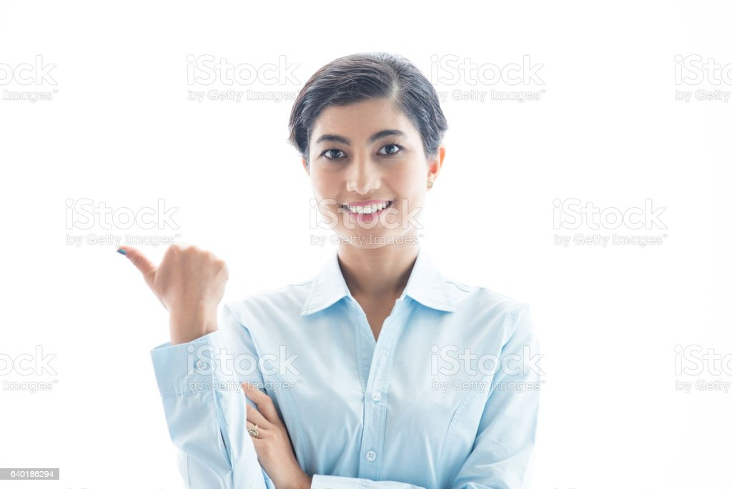 Closeup of Smiling Asian Woman Pointing Away stock photo