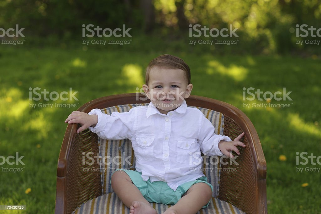 Closeup of Smiling Baby Sitting on Chair royalty-free stock photo