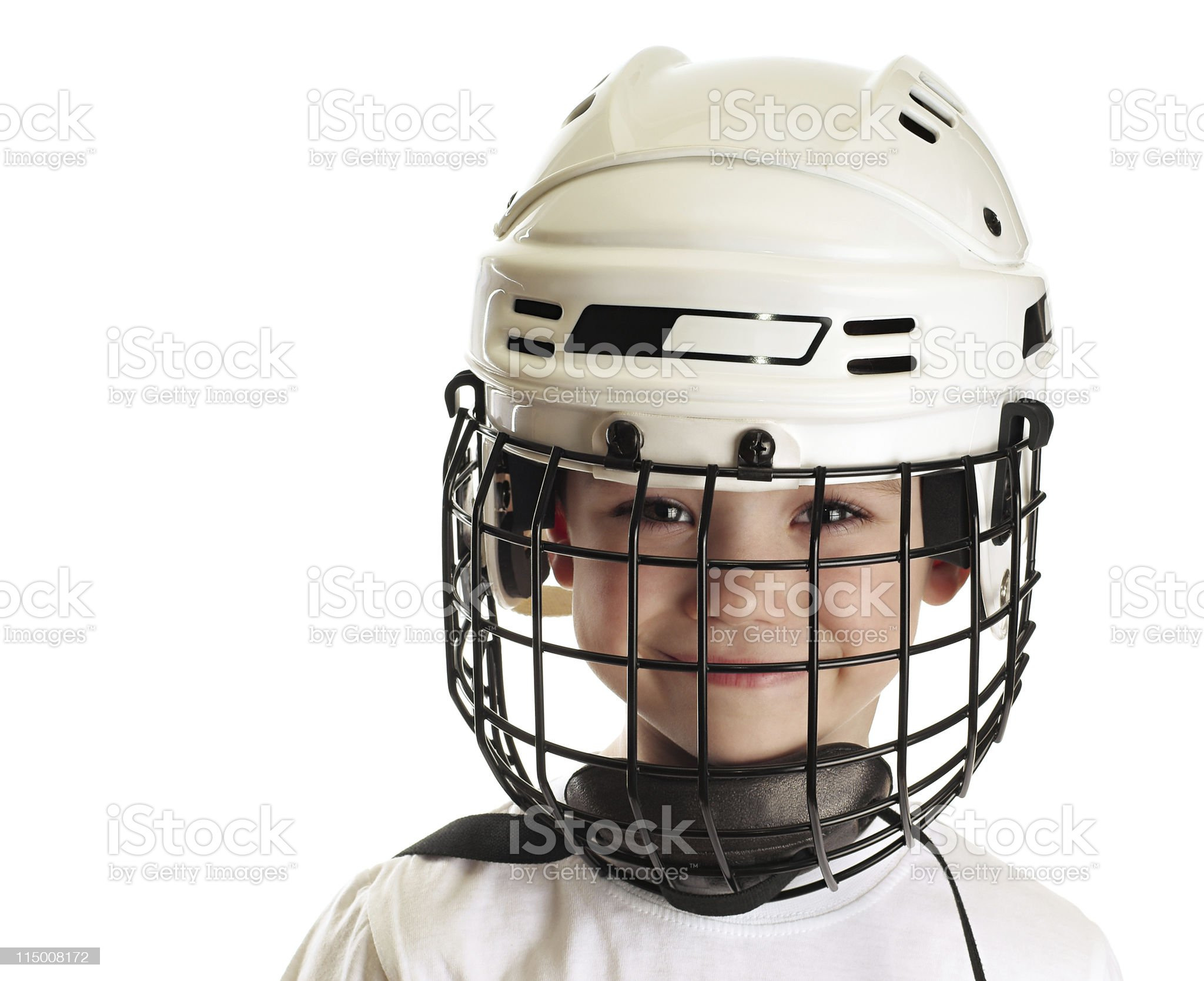Close-up of smiling boy wearing white hockey helmet royalty-free stock photo