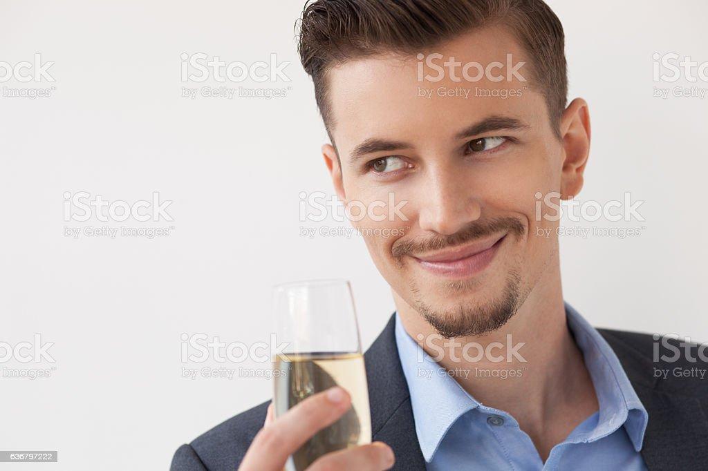 Closeup of Smiling Business Leader Raising Glass stock photo
