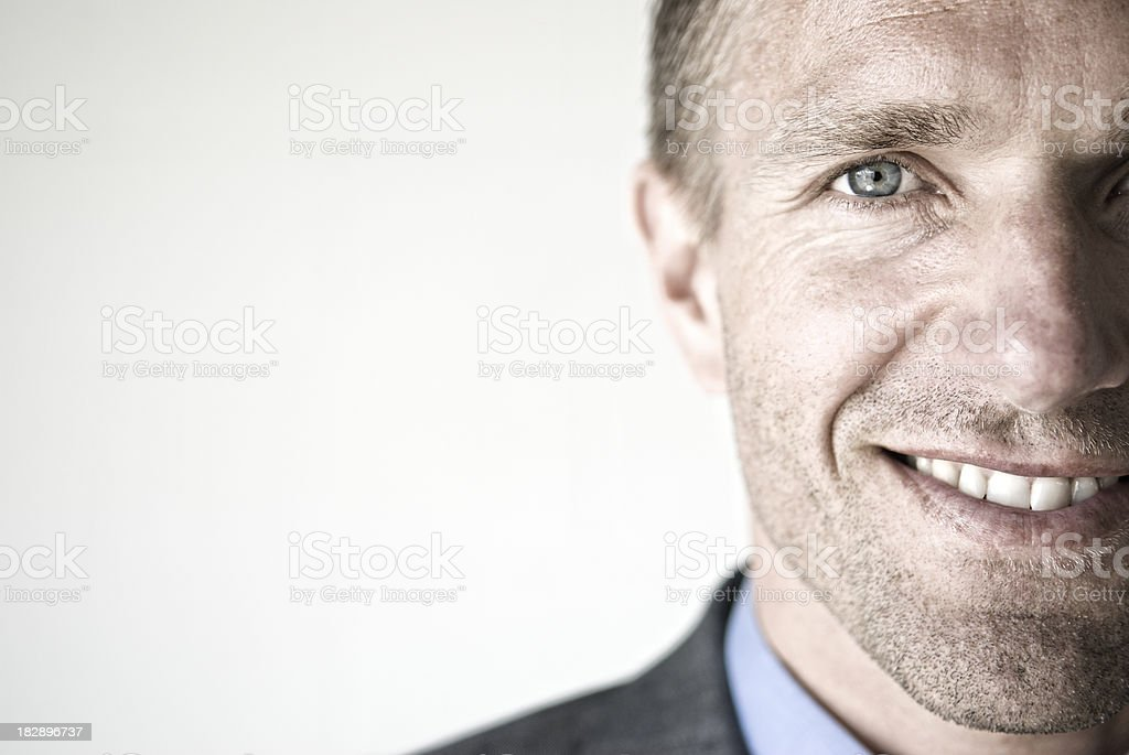 Close-Up of Smiling Businessman Face with White Copy Space stock photo