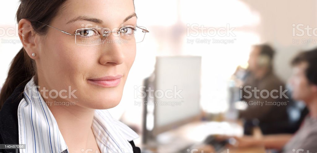 Close-up of smiling businesswoman with blurred background royalty-free stock photo