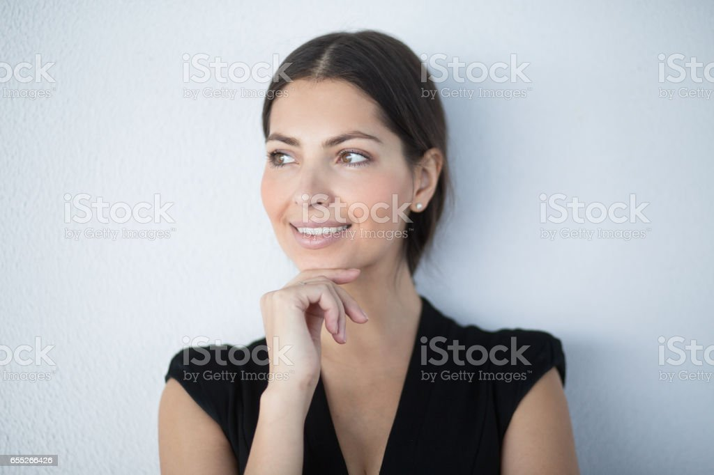 Closeup of Smiling Pensive Gorgeous Business Woman stock photo