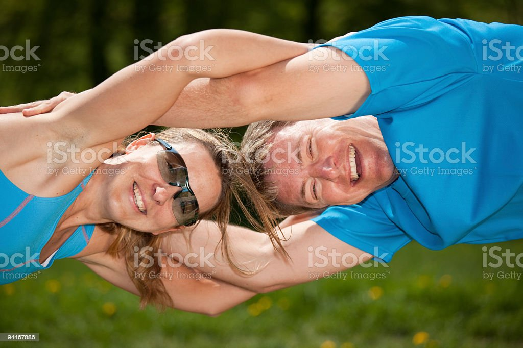 closeup of smiling sporty couple stock photo
