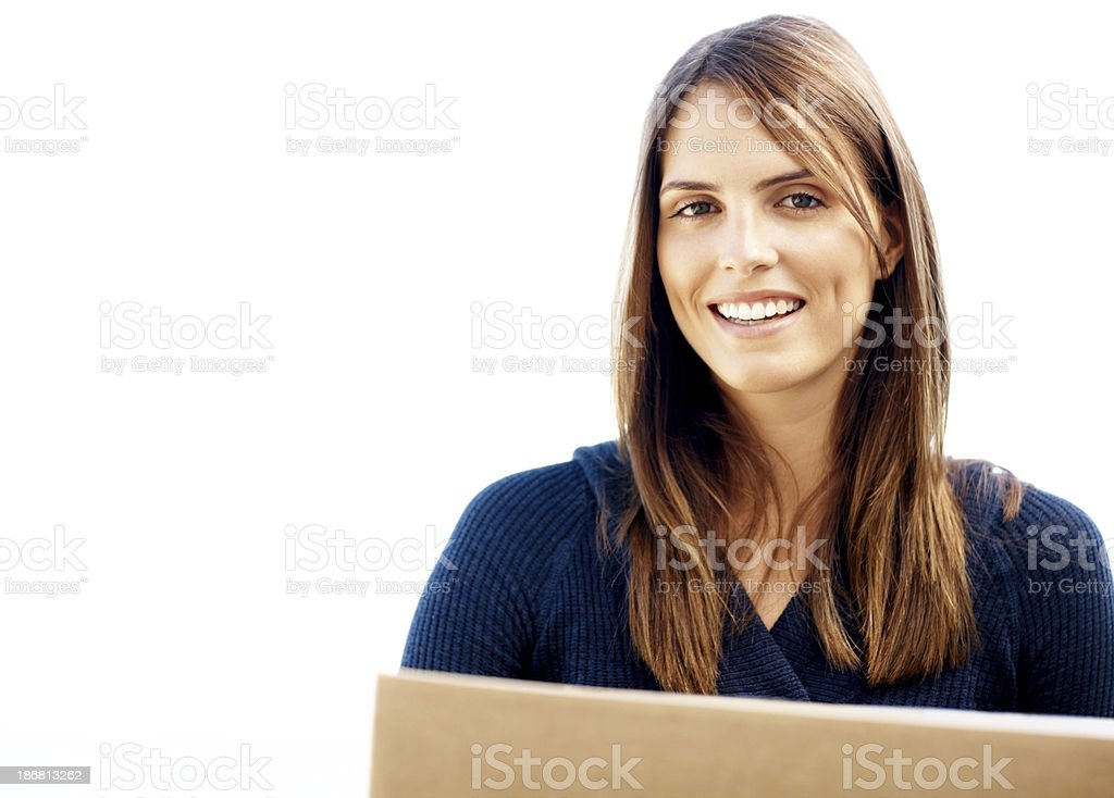 Close-up of smiling woman carrying a box against white background royalty-free stock photo