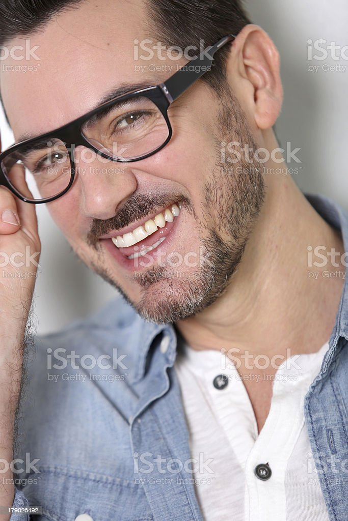 Closeup of smiling young man with eyeglasses royalty-free stock photo