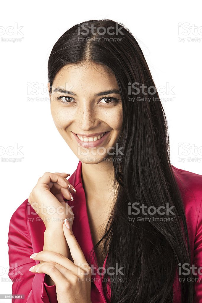 Closeup of smiling young woman over white royalty-free stock photo
