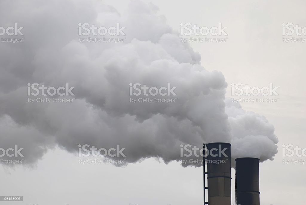 Close-up of smoke stacks contributing to air pollution royalty-free stock photo