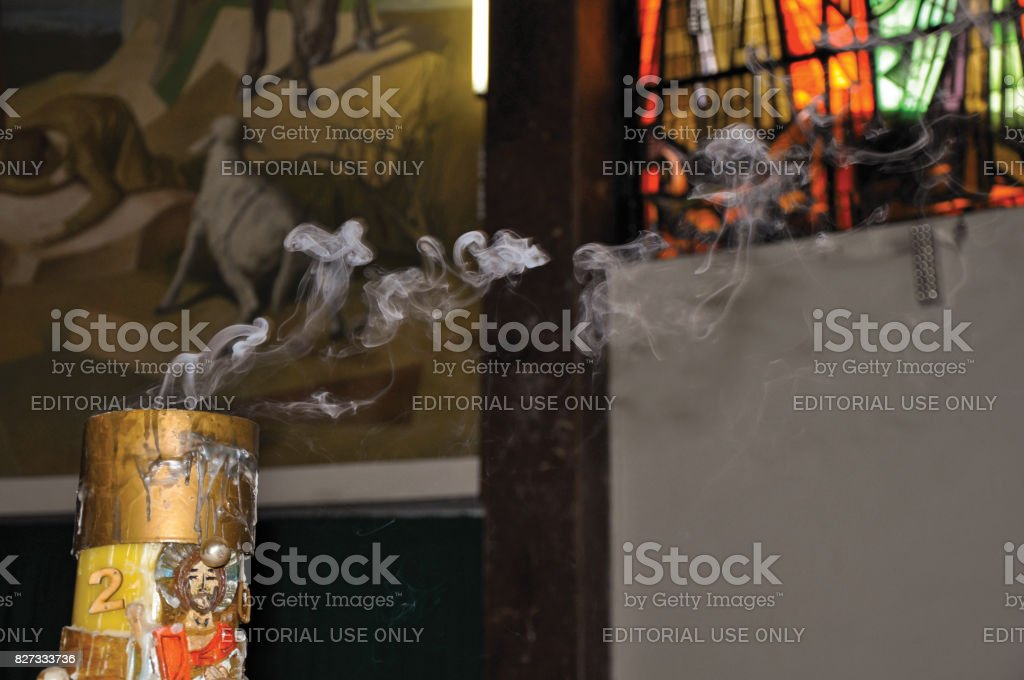Close-up of smoking candle with image of Jesus Christ in the Santuário das Almas church. stock photo