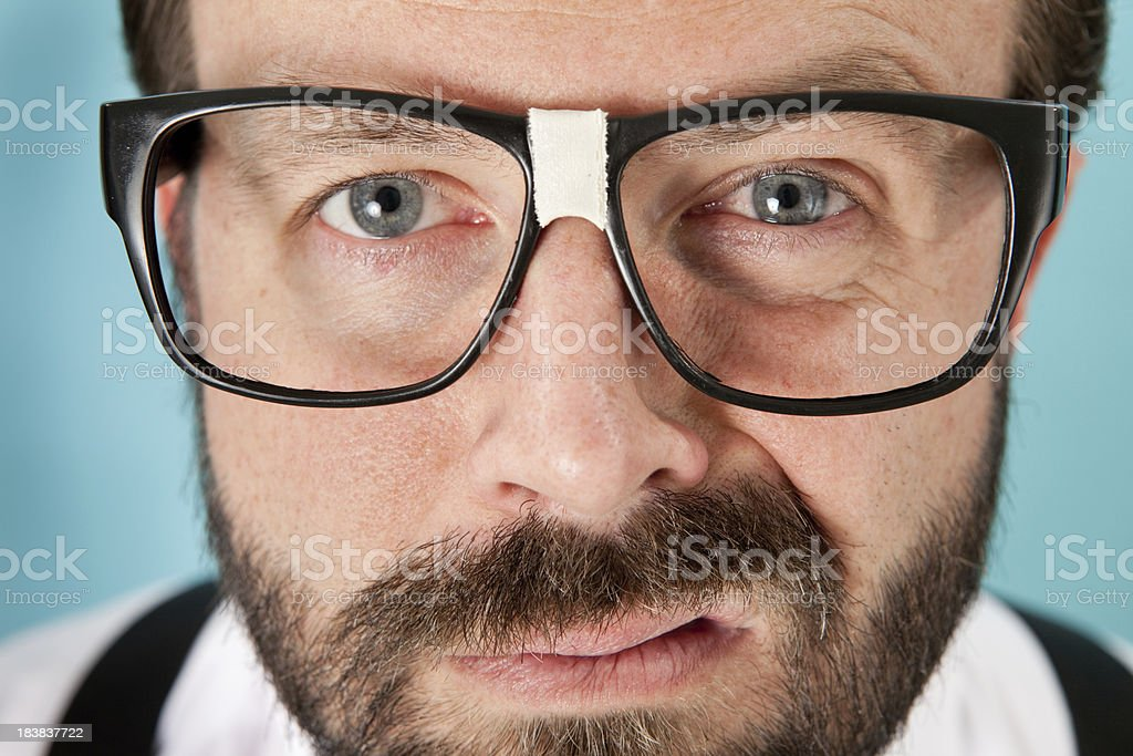 Closeup of Snarling, Nerdy Man with Glasses stock photo