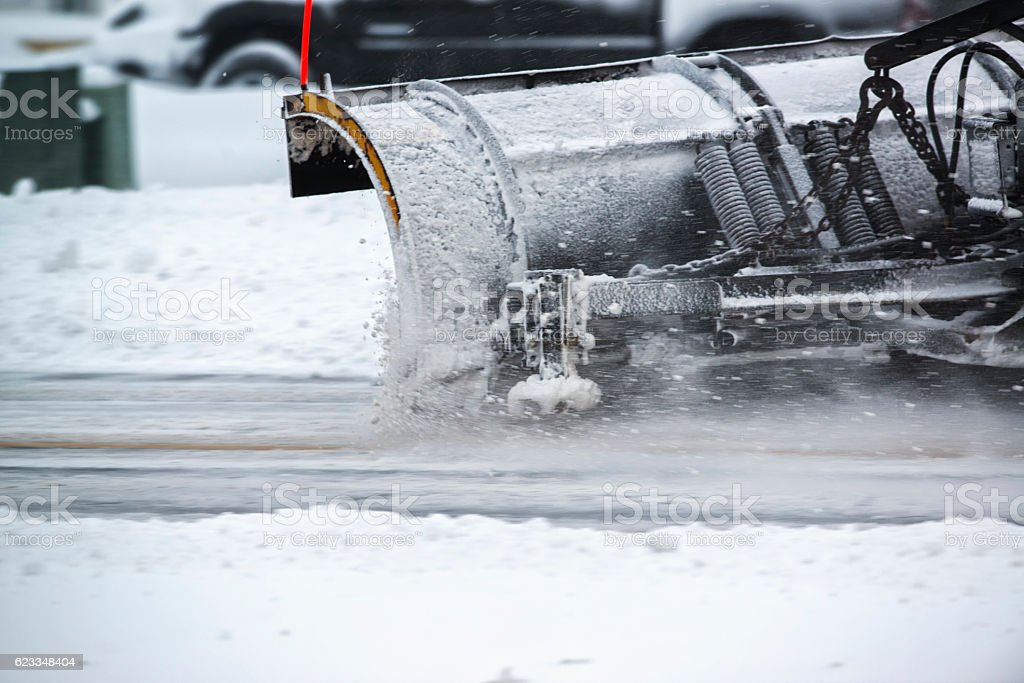 Close-up of snowplow in motion on roadway stock photo