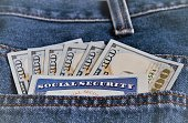 Closeup of Social security card and currency bills in jeans