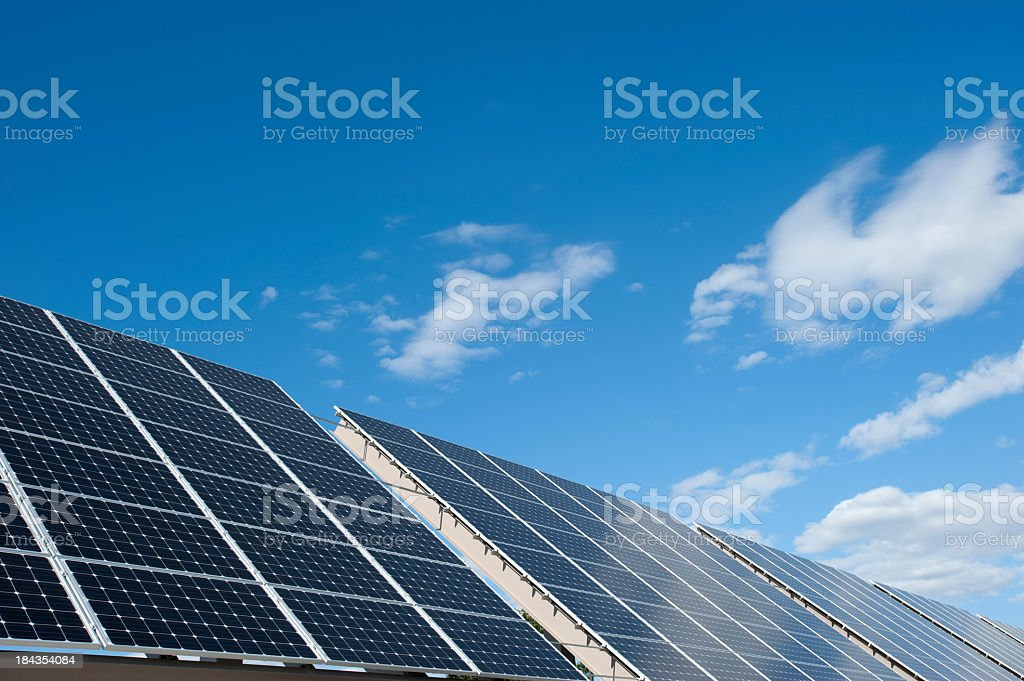 Close-up of solar arrays against a blue sky royalty-free stock photo