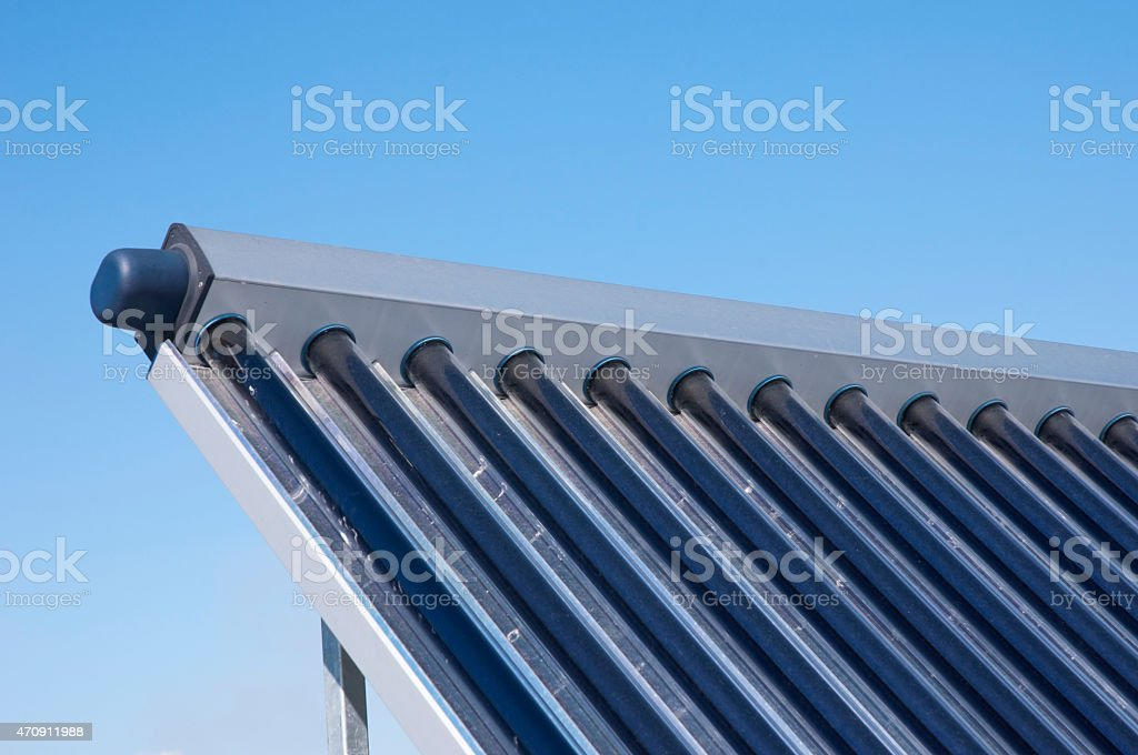 Closeup of solar water heating system on the house roof stock photo