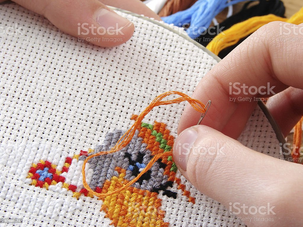 Close-up of some embroidery on some white fabric royalty-free stock photo