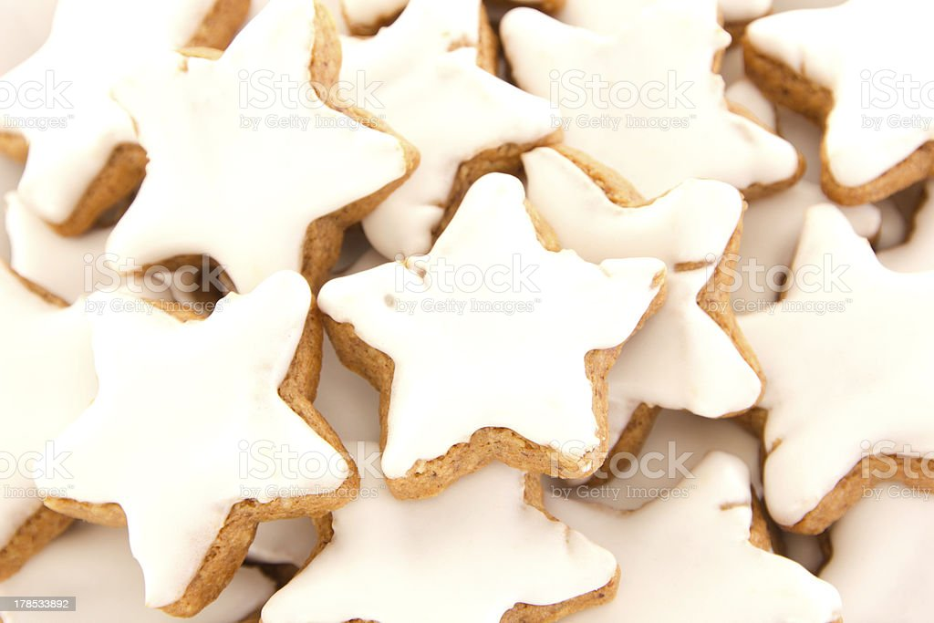Closeup of some star-shaped cinnamon biscuit royalty-free stock photo