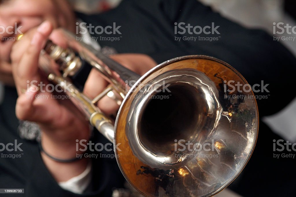 Closeup of someone playing the trumpet stock photo