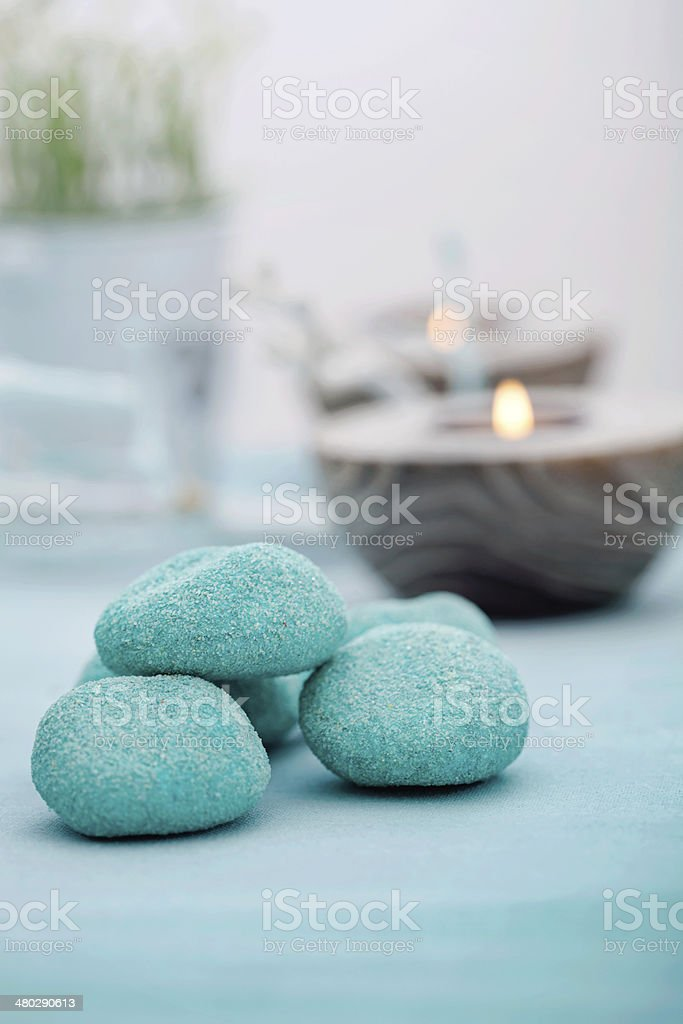 Closeup of spa setting with candles and stones stock photo