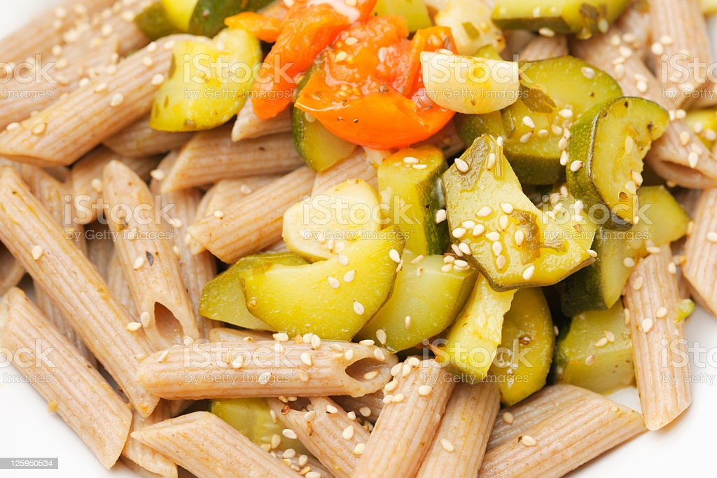 Close-Up of Spelt Pasta Dish with Zucchini and Tomatoes royalty-free stock photo