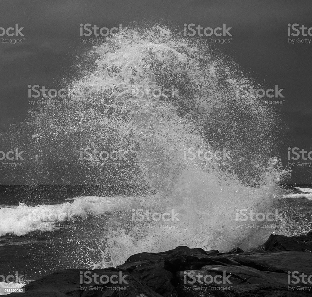 B/W Close-up of Spinning Ocean Wave stock photo