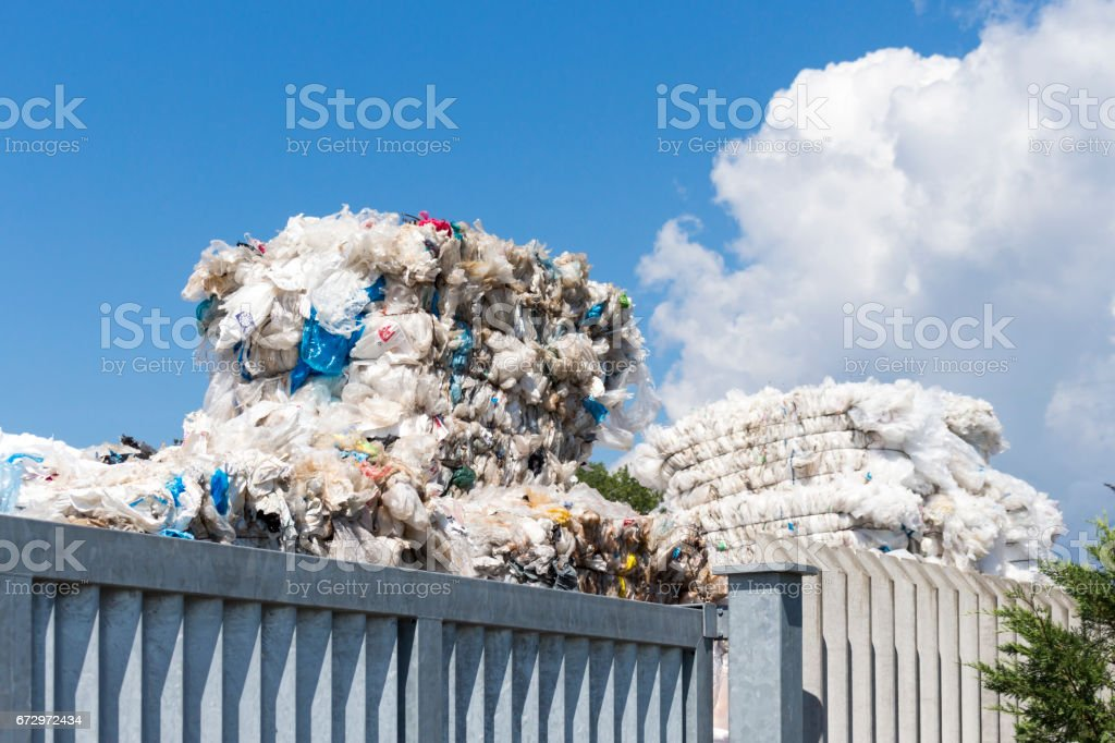 close-up of stack of plastic packaging before recycling stock photo